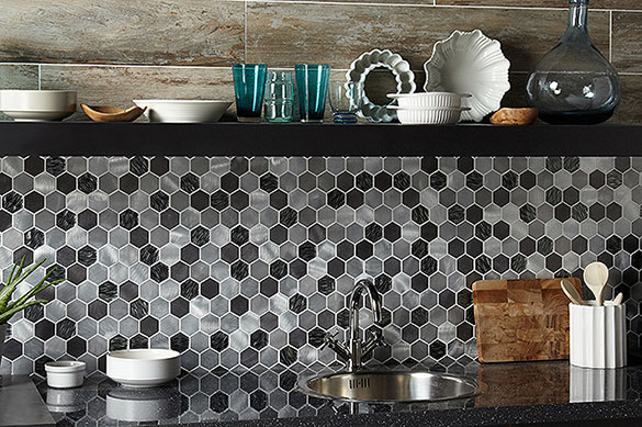 lovely contrast of metallic mosaic tiles with wood effect porcelain plank tiles