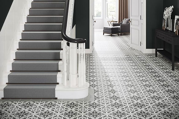 geometric floor tiles used to create a rug effect with light grey boarder tile