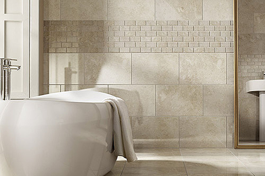 Pale marble wall and floor tiles used in this elegant family bathroom