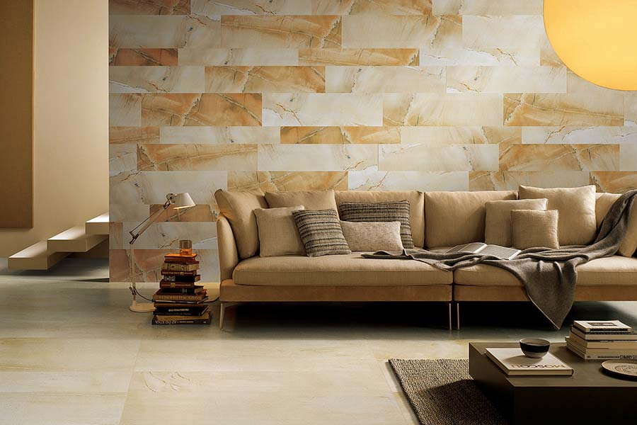 Sandstone effect porcelain tiles in a rich golden colour have been used to create this eye-catching feature wall