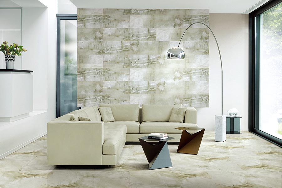 Sandstone effect thin porcelain tiles have been used to create a stunning feature wall in this modern lounge