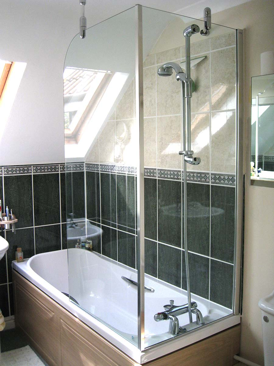 A Traditional Style Loft Bathroom With Innovative Fixed Over Bath Shower Screen 2 Sides