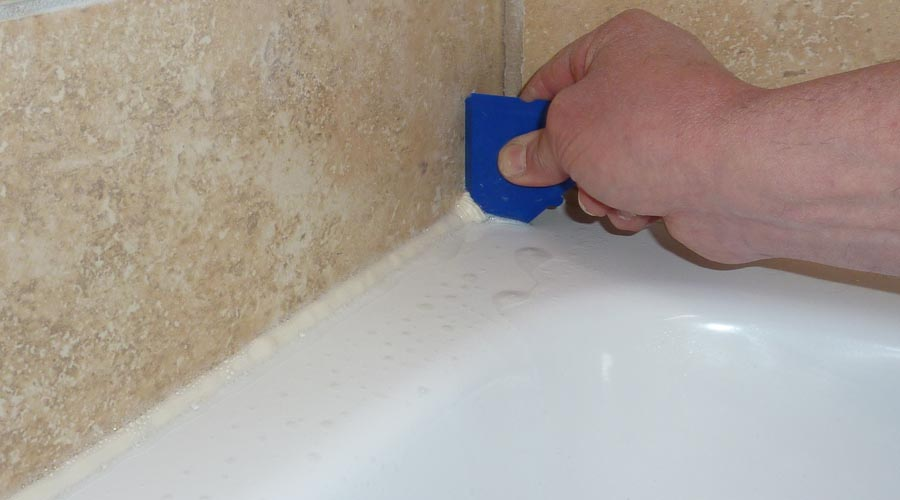 A Fugi silicone sealant application tool is used to remove excess  sealant and leave a neat. How to Seal a Shower Tray Tips   Advice