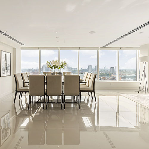 A Luxury dining room featuring Porcel-Thin Mono China Clay polished porcelain 900x900m floor tiles