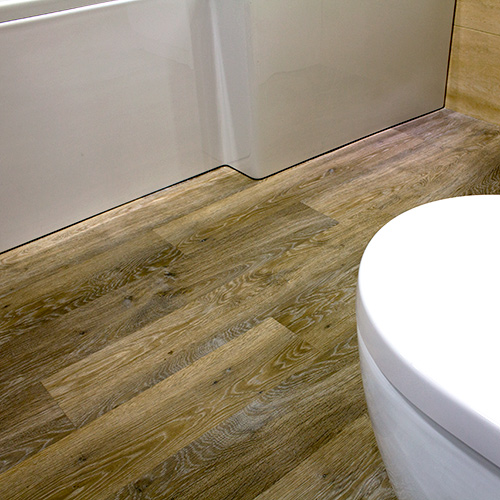 This modern bathroom dispaly at UK Tiles Direct in Wareham features Karndean wood effect plank vinyl flooring
