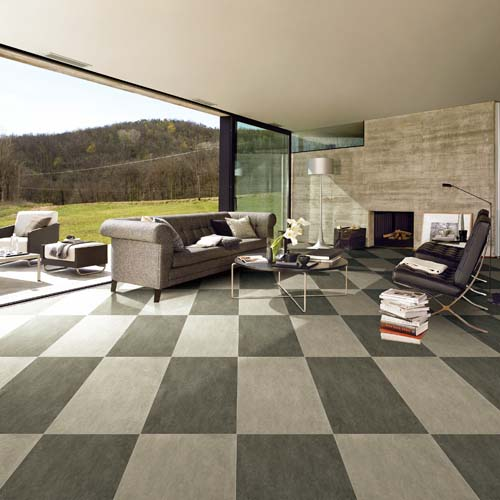 Matt finish sandstone porcelain tiles by Porcel-Thin in a large modern lounge