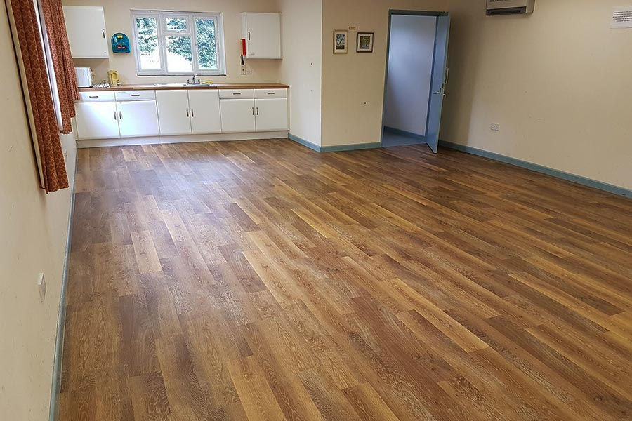 The main hall and kitchen at Stoborough village Hall with new Classic Limed Oak vinyl plank flooring from the Karndean Knight Tile Collection
