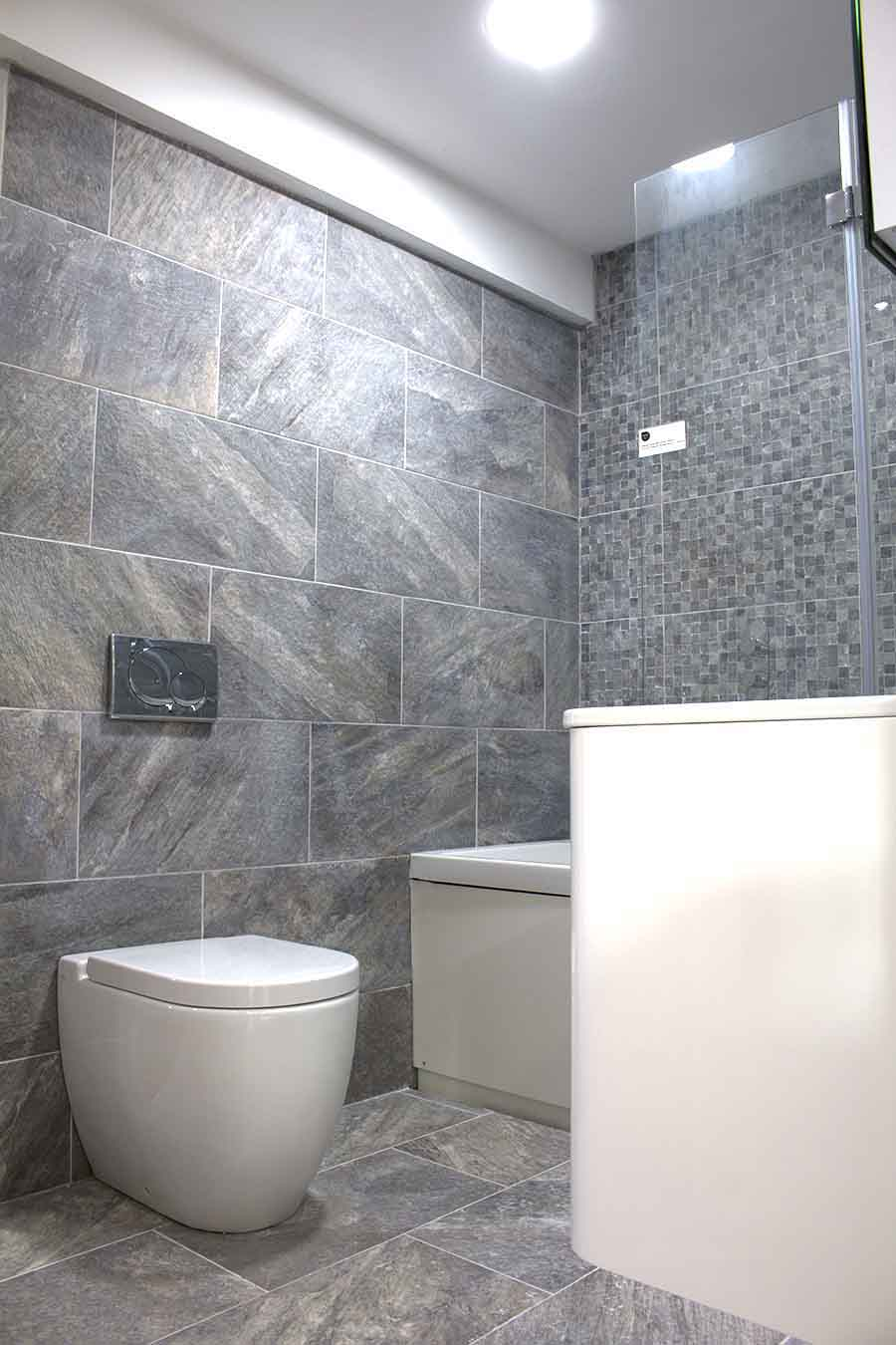 Roper Rhodes luxury bathroom suite with Marazzi stone effect wall and floor tiles