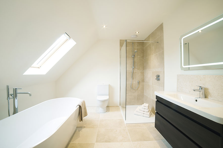 Luxury bathroom with large porcelain tiles and glass walkin shower