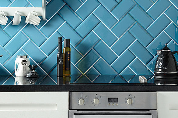 bright blue brick style porcelain tiles laid in a brick pattern for a kitchen splash back