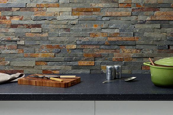 This industrial look kitchen splash back features Verona split face slate tiles