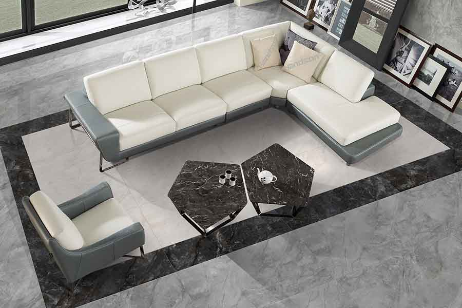 This elegant lounge features marble effect floor tiles from Porcel-Thin in Luna Grey colour