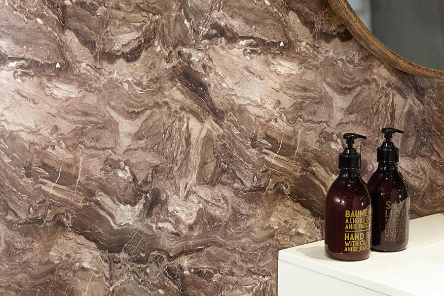 Bushboard stone effect bathroom splashback in Terracotta