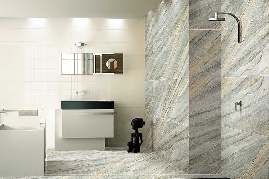A large modern wetroom featuring large 120x60cm thin stone effect porcelain tiles from Porcel-Thin