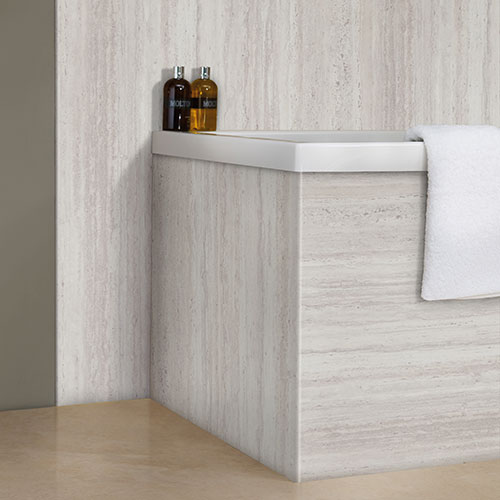 This smart and modern bathroom is clad with Platinum Travertine silver grey travertine effect bathroom wall boards