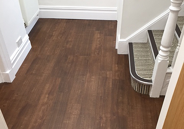 New dark wood Karndean vinyl floor tiles installed by UK Tiles for Denistry @ 68 of Poole