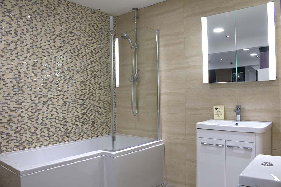 This modern bathroom features wood effect floor tiles with stunning Nacar Arena glass and stone mosaic wall tiles